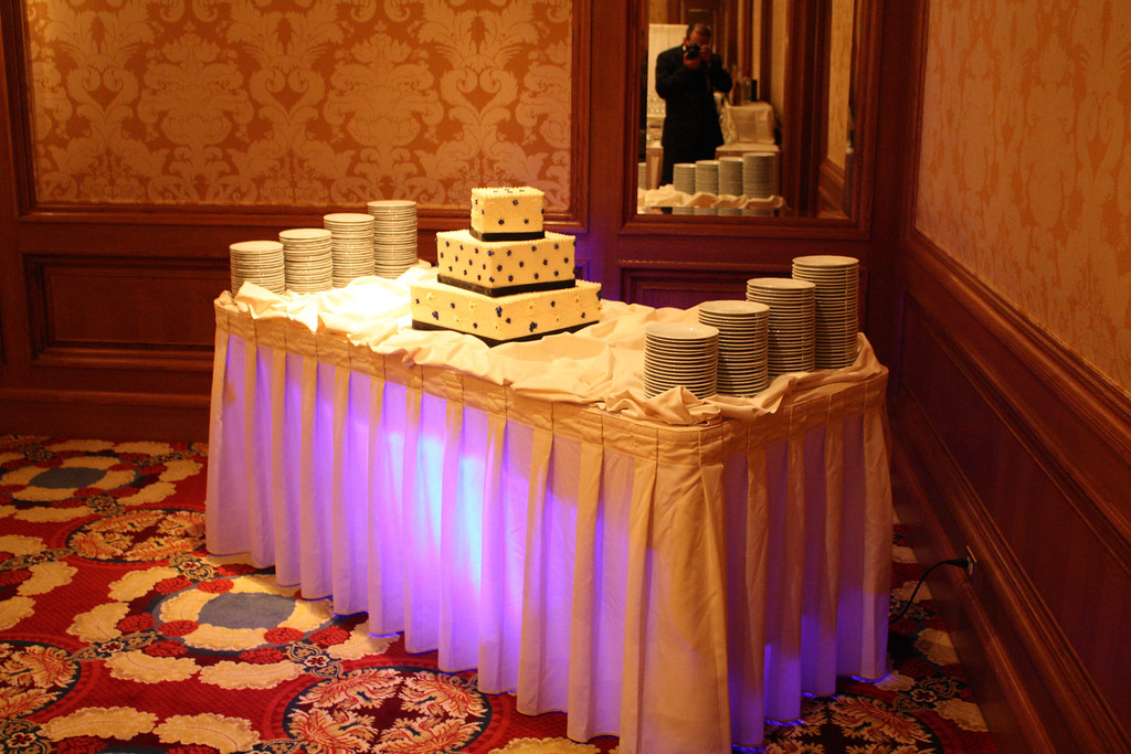 Uplighting under the cake table to accent the cake.