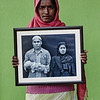 Senwara with one of my photos of her family.