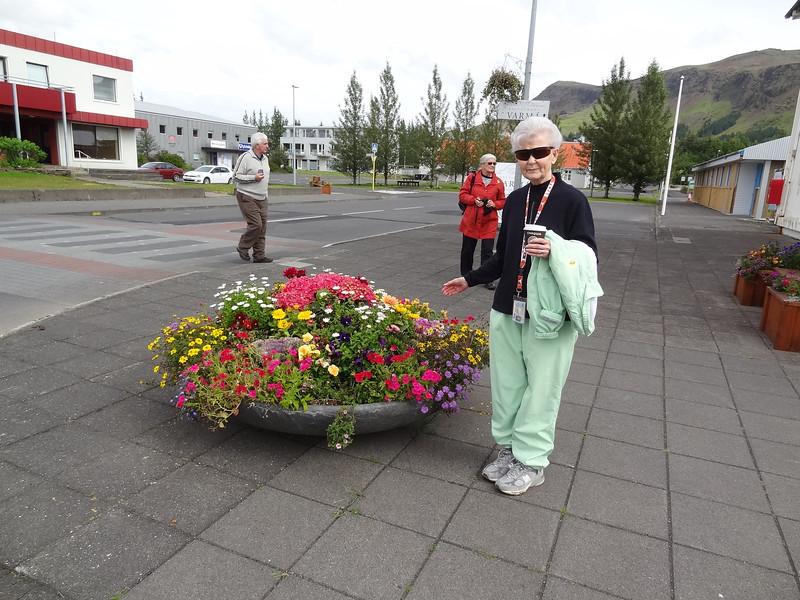 DSC02907 07/28/2013  12:15 PM Larie admiring city flower pots
