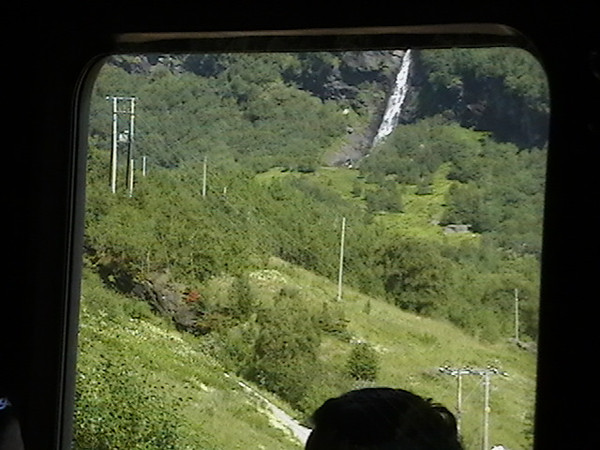 arrange mode ?<br />  <br />  hide photo ?<br />  <br /> IMGA0075  image behind train window on outbound leg of Flam RR