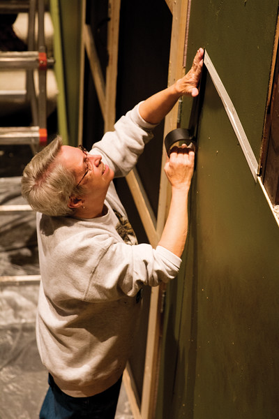 "Matthew Gaston | The Sheridan Press<br>Pat Trout goes about making the backdrop for the WYO Theatre's production of ""The Addams Family"" seamless Tuesday, Oct. 16, 2018."