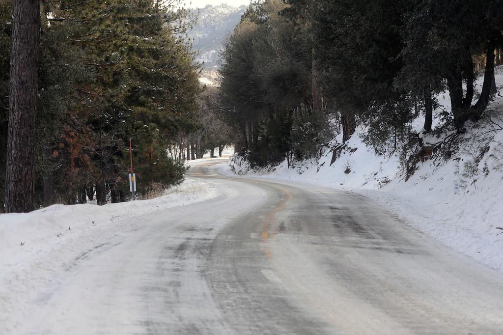 . Snow and ice cover Highway 138 heading to Crestline, Ca. on Wednesday, December 3, 2014. (Staff Photo by Sarah Alvarado/ San Bernardino Sun)