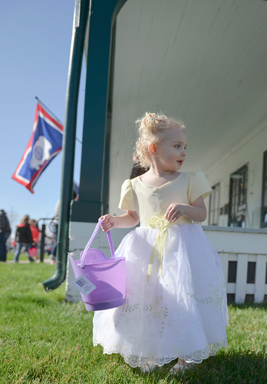 Justin Sheely | The Sheridan Press<br /> Two-year-old Haili Hirch looks for eggs during the Easter Egg Hunt Saturday morning at the Historic Sheridan Inn.