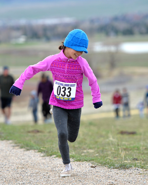 "Justin Sheely | The Sheridan Press<br /> Eight-year-old Hannah Mowry charges up the hill during the ""Lead the Way"" 5k Saturday at Soldier Ridge Trail in Sheridan. The race was organized by Sheridan High School's National Honors Society to support Wyoming Big Brothers Big Sisters."