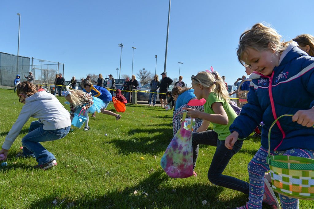 "Justin Sheely | The Sheridan Press<br /> Children ""hunt"" for eggs during Sheridan Recreation District's Easter Egg Hunt Saturday morning Thorne-Rider Park."