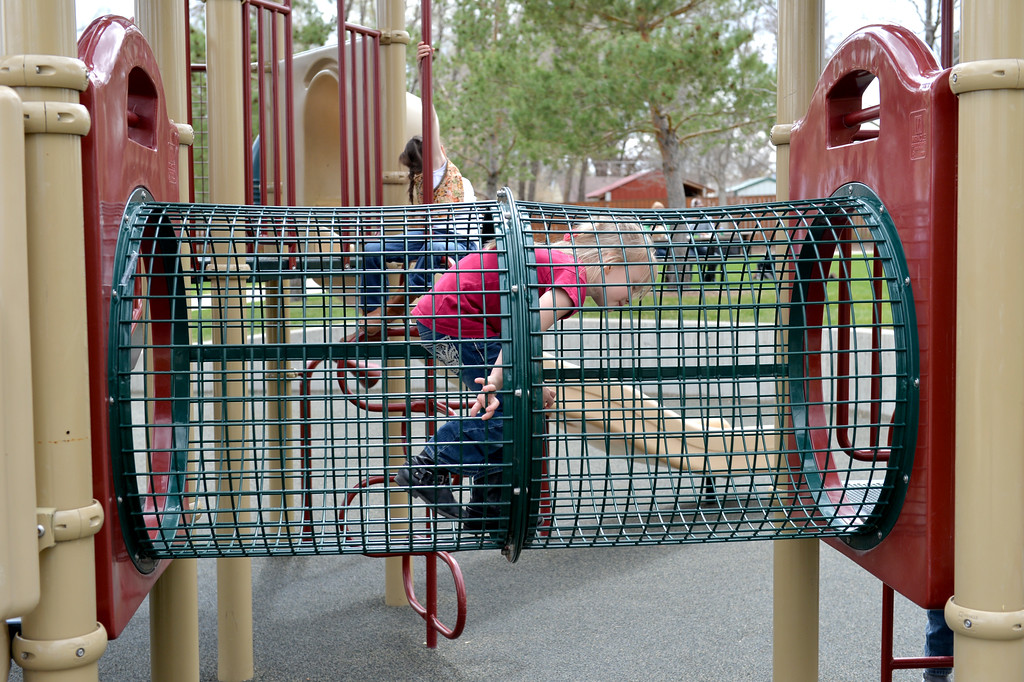 Justin Sheely | The Sheridan Press<br /> Five-year-old Abigale Watson plays in the playground Friday at Whitney Commons. The weekend is expected to be mostly sunny with high temperatures in the mid-to-high 50s.
