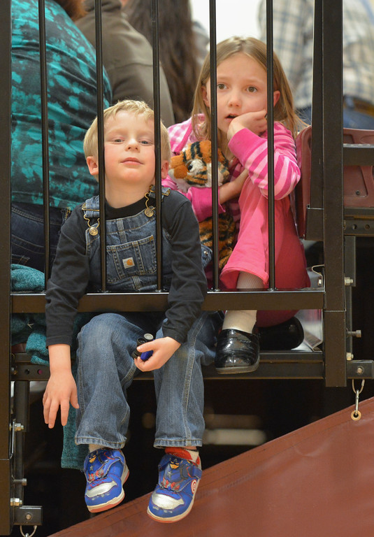 Justin Sheely | The Sheridan Press<br /> Four-year-old Noah Watson, left, and Madison Thom, 7, hangout on the bleachers during the boys basketball game against Moorcroft Saturday at Big Horn High School.