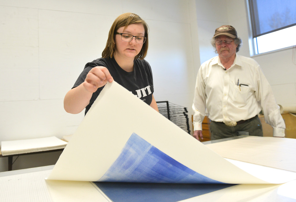 "Justin Sheely | The Sheridan Press<br /> Campbell County student Anneliese Schnabel lifts her print from the printing press during a printmaking workshop led by renowned artist Theodore Waddell Wednesday in the Whitney Center for the arts at Sheridan College. Waddell donated his printing press, supplies and entire print collection to the printmaking program at Sheridan College. Theodore Waddell and his daughter Arin Waddell have a joint gallery ""Waddell + Waddell"" in the Whitney Center for the Arts. The artist reception is free and open to the public Thursday, February 16, 5p.m. to 7 p.m."