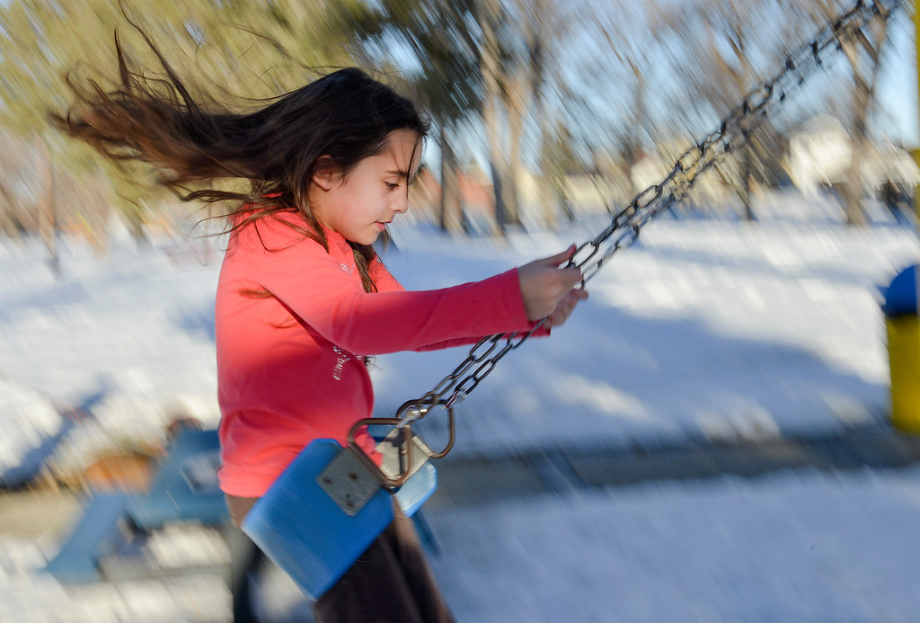 Justin Sheely | The Sheridan Press<br /> Ten-year-old Cadence Gross plays on a swing on a warm Tuesday afternoon in Kendrick Park. Much of this week will expect to see high temperatures in the high 50's.