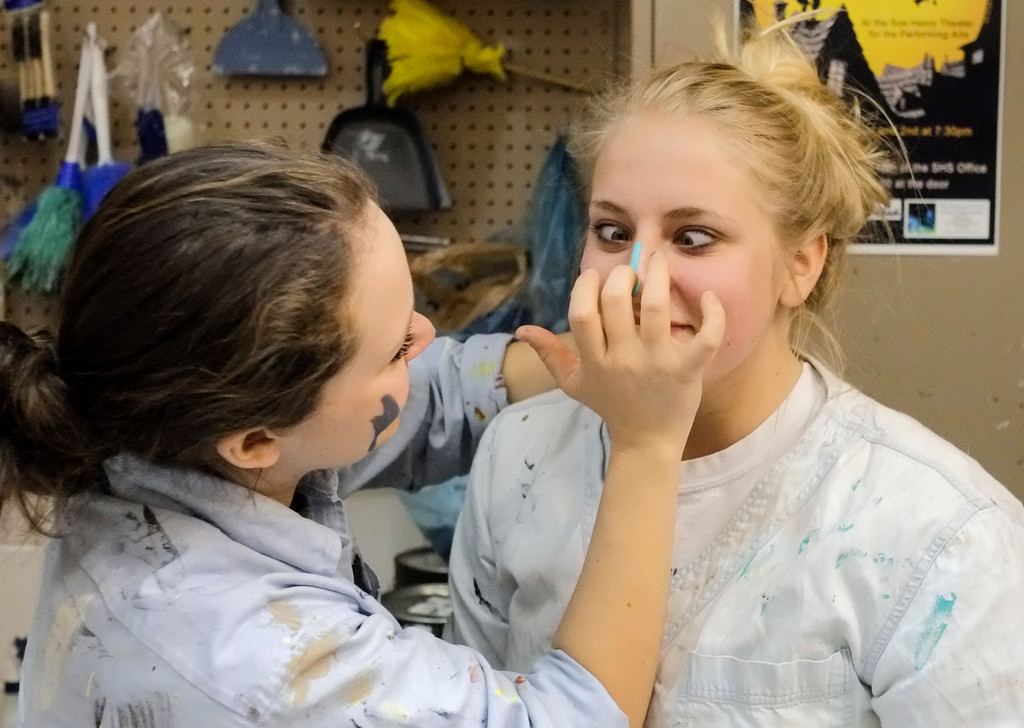 """Justin Sheely   The Sheridan Press<br /> Sheridan junior Sage Koltiska reacts as Katie Bammel smears paint on her nose during set construction Saturday morning for the upcoming play """"Bye Bye Birdie"""" at Sheridan High School. Performances are Thursday, Friday and Saturday, March 2, 3 and 4 at 7:30 p.m. and Sunday, March 5 at 2 p.m. Tickets are available for purchase at the WYO Theater."""