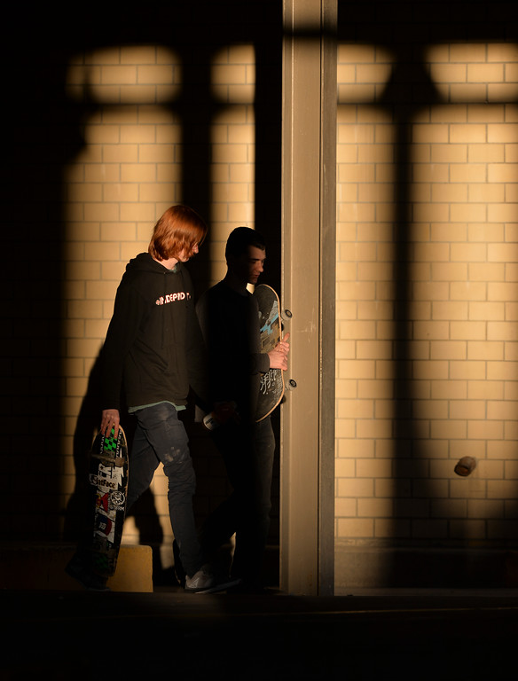 Justin Sheely | The Sheridan Press<br /> Skateboarders walk past a beam of sunlight under the parking garage Wednesday evening in downtown Sheridan. Wednesday's high was 63 degrees fahrenheit – the rest of the week is expected to be warm.