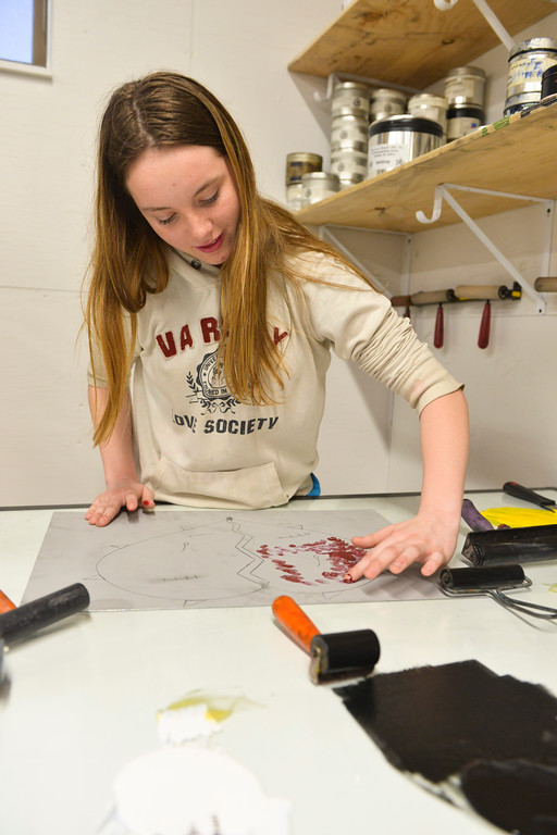 "Justin Sheely | The Sheridan Press<br /> Fort Mackenzie High School student Vikki Swinyer uses her fingers to apply ink to her art during a printmaking workshop led by renowned artist Theodore Waddell Wednesday in the Whitney Center for the arts at Sheridan College. Waddell donated his printing press, supplies and entire print collection to the printmaking program at Sheridan College. Theodore Waddell and his daughter Arin Waddell have a joint gallery ""Waddell + Waddell"" in the Whitney Center for the Arts. The artist reception is free and open to the public Thursday, February 16, 5p.m. to 7 p.m."