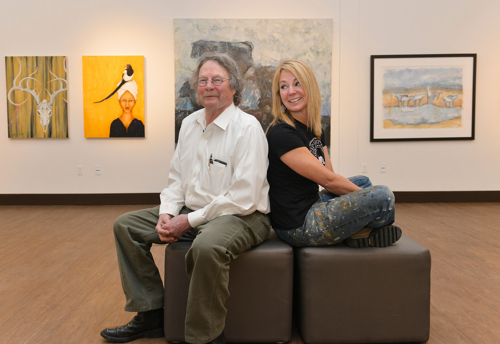 "Justin Sheely | The Sheridan Press<br /> Father and daughter artists Theodore Waddell and Arin Waddell pose for a portrait in their joint gallery ""Waddell + Waddell"" Wednesday in the Whitney Center for the Arts at Sheridan College. The artist reception is free and open to the public Thursday, February 16, 5p.m. to 7 p.m. at the Whitney Center for the Arts."