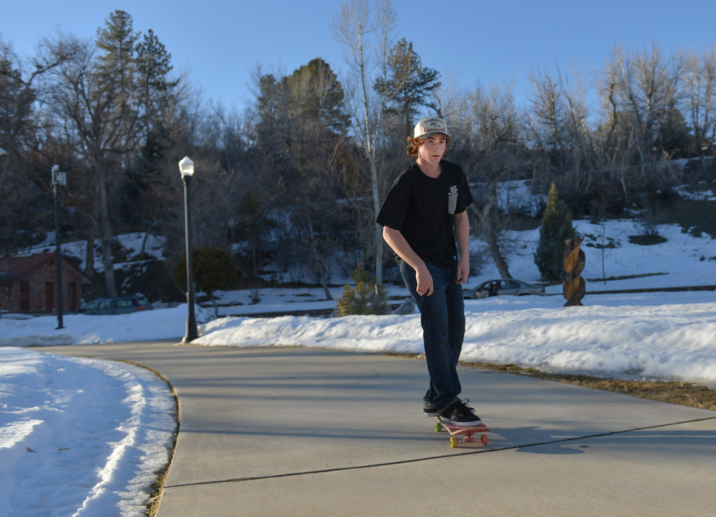 Justin Sheely | The Sheridan Press<br /> Jesse McEachran rides his skateboard down the path on a warm Tuesday afternoon in Kendrick Park. Much of this week will expect to see high temperatures in the high 50's.