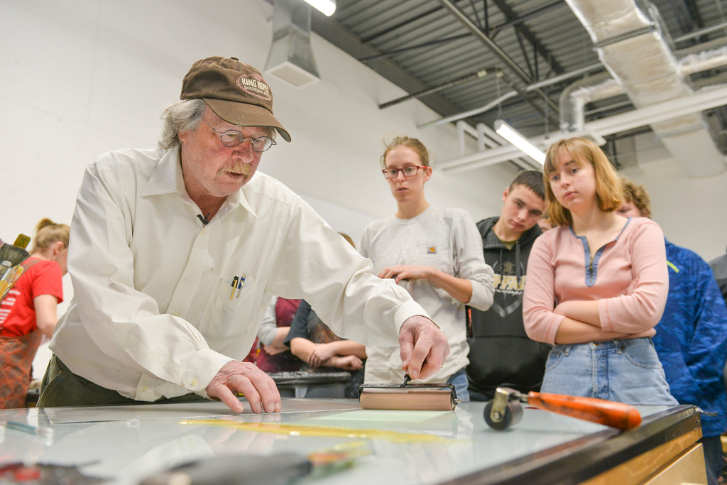 "Justin Sheely | The Sheridan Press<br /> Renowned artist Theodore Waddell leads a monotype printmaking workshop with local high school students Wednesday in the Whitney Center for the arts at Sheridan College. Waddell's work was selected to be displayed in U.S. Embassies throughout the world. Waddell donated his printing press, supplies and entire print collection to the printmaking program at Sheridan College. Theodore Waddell and his daughter Arin Waddell have a joint gallery ""Waddell + Waddell"" in the Whitney Center for the Arts. The artist reception is free and open to the public Thursday, February 16, 5p.m. to 7 p.m."