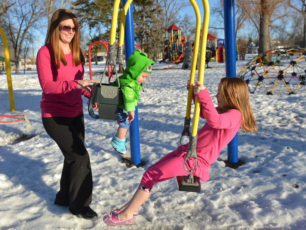 Justin Sheely   The Sheridan Press<br /> Kristie Garriffa pushes the tandem swing with her children Maverick Garriffa, 1, and Lexie Reimers, 8, on a warm Tuesday afternoon in Kendrick Park. Much of this week will expect to see high temperatures in the high 50's.
