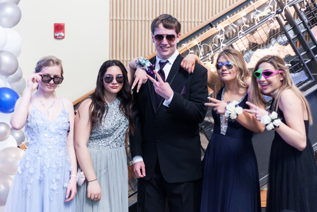 Tibby McDowell   The Sheridan Press From left, Gina Ringley, Ludovica Cuttupia, James Robert Scott, Shyan Davidson, and Jenny Trabert take pictures to pass the time while the dance floor is being set up for the Big Horn High School Prom at the Whitney Academic Center at Sheridan College Saturday, April 7, 2018.