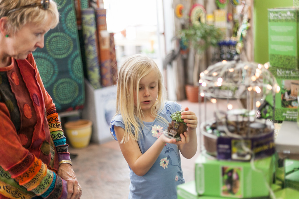 Tibby McDowell   The Sheridan Press Ellen Hepp, left, helps seven-year-old Paige Walden choose items for her miniature garden during the Fairy Gardening workshop at Landon's Greenhouse and Nursery Saturday, April 7, 2018.