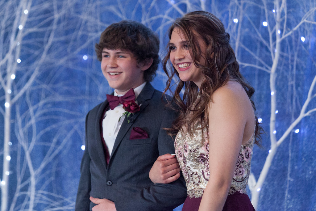 Tibby McDowell   The Sheridan Press Bode Neesen, left, and his date Amanda Anderson, cross the stage in front of family and friends during the Big Horn High School Prom at the Whitney Academic Center at Sheridan College Saturday, April 7, 2018.