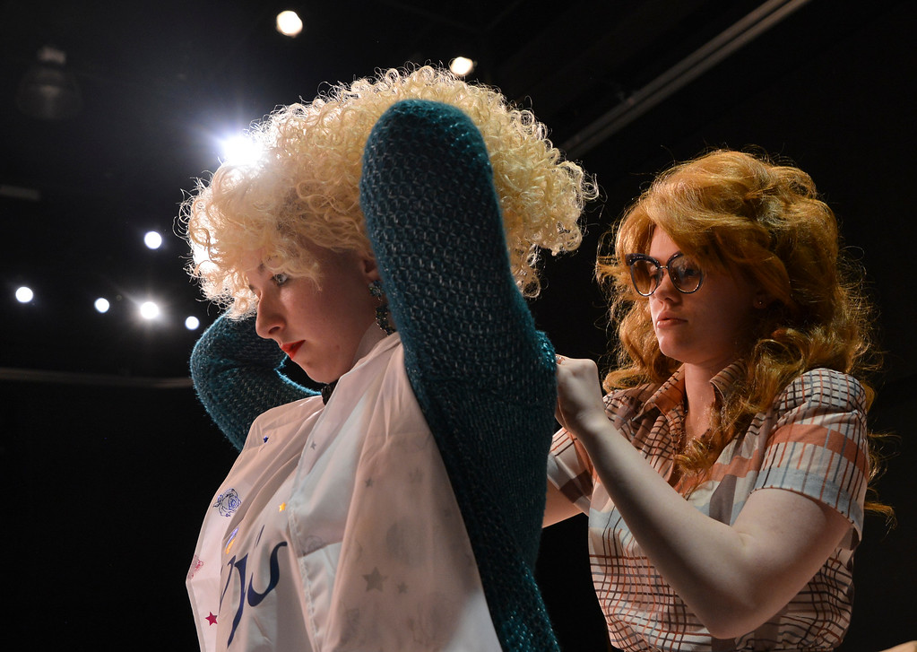 """Justin Sheely   The Sheridan Press<br /> Theater student Victoria Waterhouse, left, holds up her hair as Calie Siplon puts a cape on during a rehearsal of Robert Harling's """"Steel Magnolias"""" at the Mars Theater at the WYO Performing Arts and Education Center Thursday, April 5, 2018. The play, presented by the Sheridan College theater program and directed by DannyLee Hodnett, runs April 12 - 14 at 7 p.m. and April 15 at 2 p.m. at the Mars Theater. Tickets are available at the WYO Theater box office and online."""