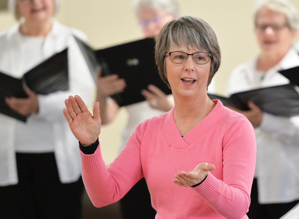 """Justin Sheely   The Sheridan Press<br /> Director Jane Perkins gets the audience clapping during the Sheridan Aires performance """"Sing into Spring"""" at The Hub on Smith Thursday, April 5, 2018."""