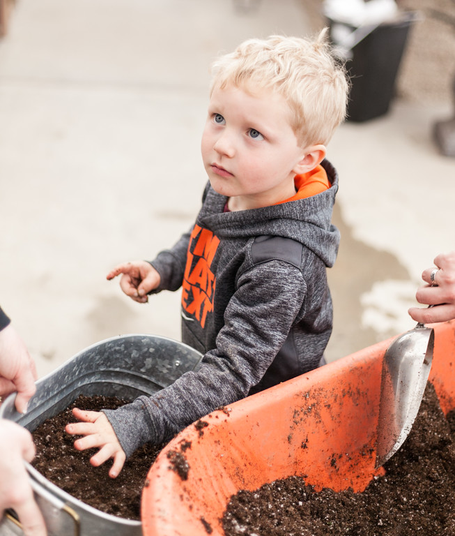 Tibby McDowell   The Sheridan Press Three-year-old Bode Ohmstede chooses to use his hands to fill the planter with potting soil during the Fairy Gardening workshop at Landon's Greenhouse and Nursery Saturday, April 7, 2018.