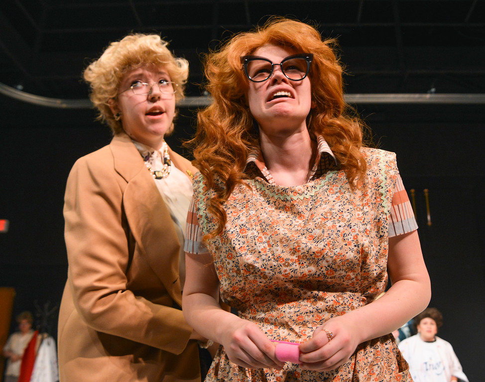 """Justin Sheely   The Sheridan Press<br /> Theater students Joely Mueller, left, and Calie Siplon look out of a window during a rehearsal of Robert Harling's """"Steel Magnolias"""" at the Mars Theater at the WYO Performing Arts and Education Center Thursday, April 5, 2018. The play, presented by the Sheridan College theater program and directed by DannyLee Hodnett, runs April 12 - 14 at 7 p.m. and April 15 at 2 p.m. at the Mars Theater. Tickets are available at the WYO Theater box office and online."""