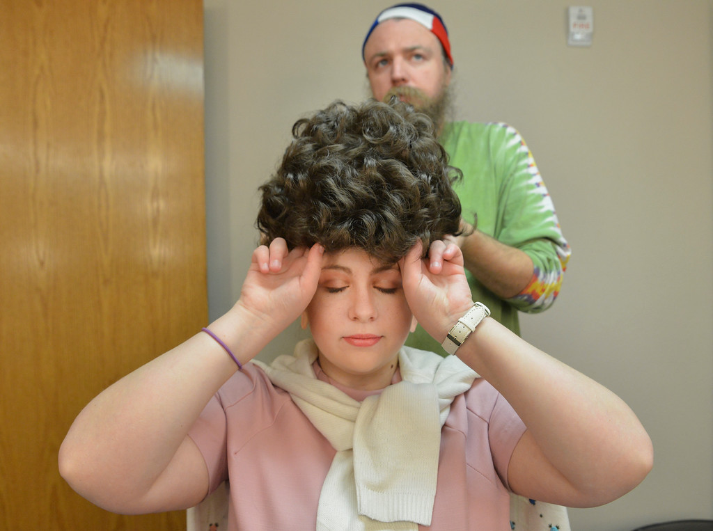 """Justin Sheely   The Sheridan Press<br /> Hair and makeup designer Ron Wolek of Orlando, Florida, places a wig on acting student Marlee Holdeman, as Shelby, during a rehearsal of Robert Harling's """"Steel Magnolias"""" at the Mars Theater at the WYO Performing Arts and Education Center Thursday, April 5, 2018. The play, presented by the Sheridan College theater program and directed by DannyLee Hodnett, runs April 12 - 14 at 7 p.m. and April 15 at 2 p.m. at the Mars Theater. Tickets are available at the WYO Theater box office and online."""