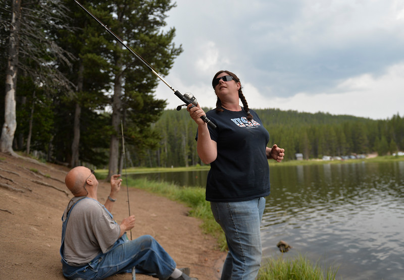 Justin Sheely | The Sheridan Press<br /> Lynda Duenow casts a fishing line at Sibley Lake in the Bighorn National Forest Wednesday, Aug. 1, 2018.