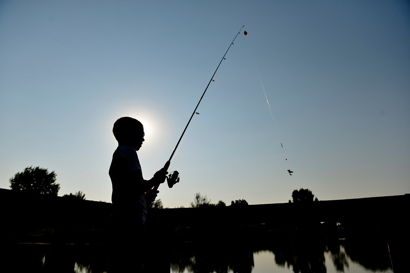 Justin Sheely | The Sheridan Press<br /> Ten-year-old Henry Williamson casts his line during the annual Fishing Derby at Rotary Pond in Ranchester Saturday, Aug. 4, 2018. The Tongue River Valley Community Center hosted the fishing derby for children under 13 and under. Children competed for most fish caught and biggest catch to win prizes.