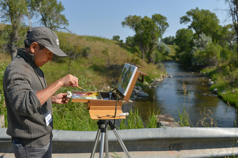 Justin Sheely | The Sheridan Press<br /> Huihan Liu of California paints from a view of the Little Goose creek for the quick draw event of the Bighorn Rendezvous Art Show and Sale at the Brinton Museum Saturday, Aug. 4, 2018.