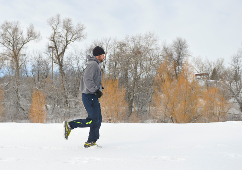 Justin Sheely | The Sheridan Press<br /> <br /> Tim Brugger run across the snowy path during the Valentine's Day fun run at Thorne-Rider Park Saturday, Feb. 17, 2018.