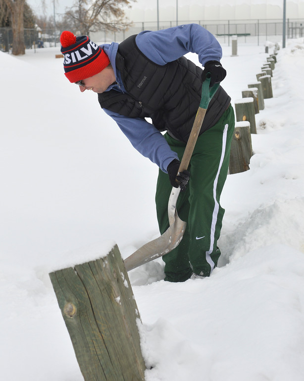 Justin Sheely | The Sheridan Press<br /> <br /> Sheridan Recreation District's Seth Ulvested shovels a path to the starting line during the Valentine's Day fun run at Thorne-Rider Park Saturday, Feb. 17, 2018.