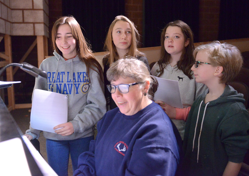 "Justin Sheely | The Sheridan Press<br /> <br /> Pianist Rosana Hednerson, center, runs through a song with students, from left, Annie Keller, Chloe Wilson, Eilidh O'Hare and Jenna White during practice for the musical performance of ""Beauty and the Beast"" at Tongue River High School Friday, Feb. 16, 2018. The play will show at Tongue River High School March 6, 7 and 8 at 7 p.m., pre-show dinner fundraiser is Tuesday, March 6 at 5:30 p.m. [Eilidh O'Hare is correct spelling]"