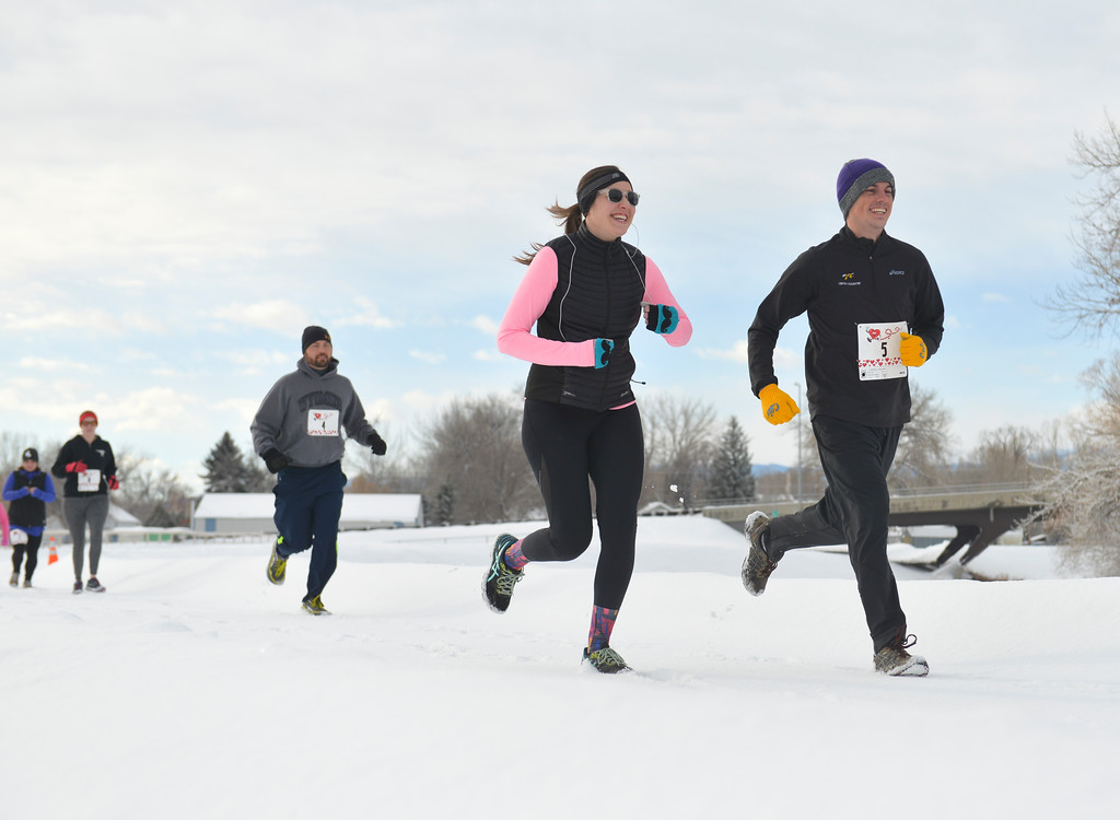 Justin Sheely | The Sheridan Press<br /> <br /> Michelle Hoistead, left, and Birch Haradan start the 6k during the Valentine's Day fun run at Thorne-Rider Park Saturday, Feb. 17, 2018.