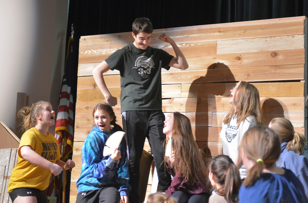 "Justin Sheely | The Sheridan Press<br /> <br /> Tony Perfetti as Gaston, center, is admired by the town's people during practice for the musical performance of ""Beauty and the Beast"" at Tongue River High School Friday, Feb. 16, 2018. The play will show at Tongue River High School March 6, 7 and 8 at 7 p.m., pre-show dinner fundraiser is Tuesday, March 6 at 5:30 p.m."