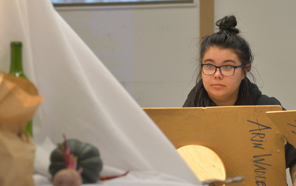 Justin Sheely | The Sheridan Press<br /> <br /> Sheridan High School dual enrolled senior Maggie Fort look at the props during Drawing 1 class at the Whitney Center for the Arts Thursday, Feb, 15, 2018.
