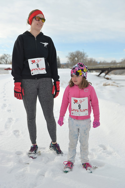 Justin Sheely | The Sheridan Press<br /> <br /> Angela Mullinax, left, and daughter Evelyn Mullinax, 5, wait at the starting line during the Valentine's Day fun run at Thorne-Rider Park Saturday, Feb. 17, 2018.
