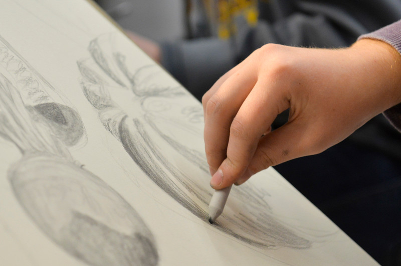 Justin Sheely | The Sheridan Press<br /> <br /> An art student uses a stub to blur the lines during Drawing 1 class at the Whitney Center for the Arts Thursday, Feb, 15, 2018.