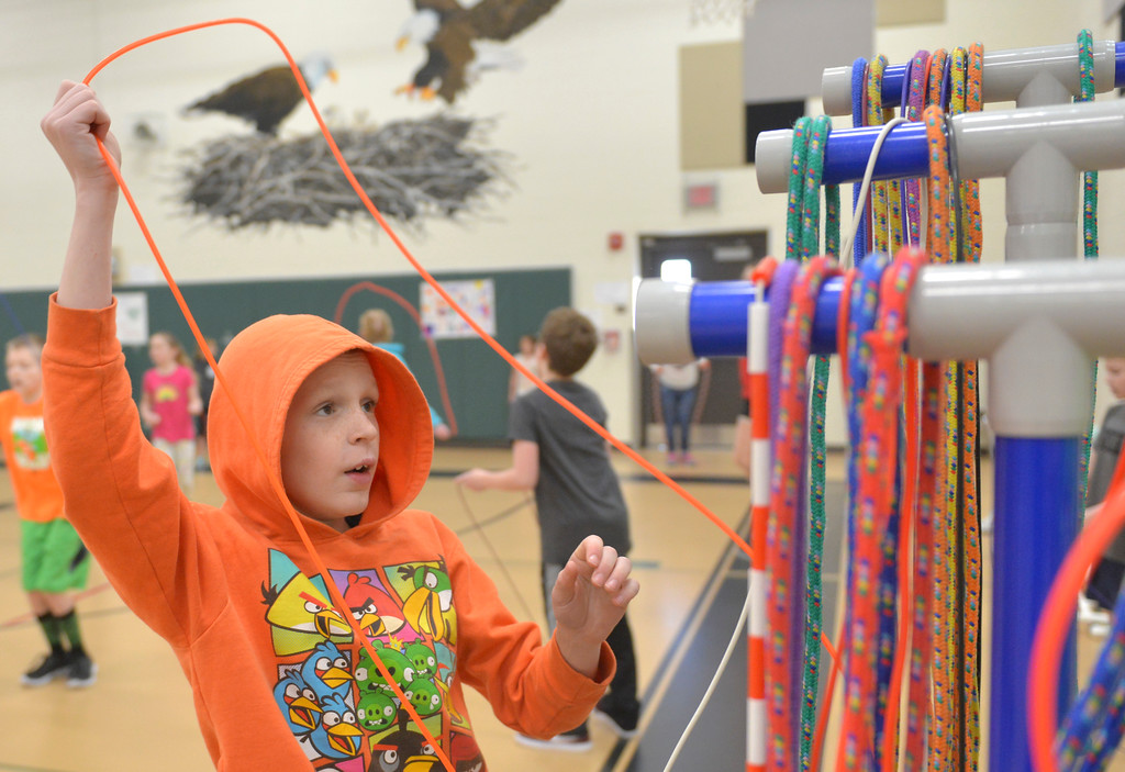 Justin Sheely | The Sheridan Press<br /> <br /> Fifth-grader Ayden Gay grabs a jump rope during the annual Jump Rope for Heart event at Tongue River Elementary Friday, Feb. 23, 2018. Jump Rope for Heart is a nation-wide program to promote exercise and healthy eating.