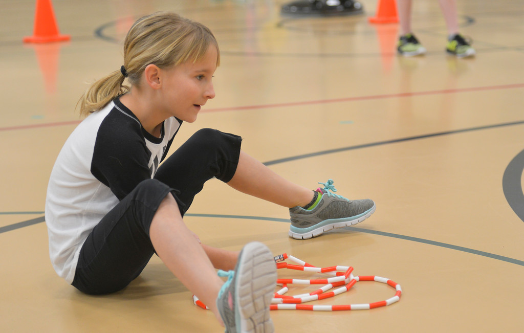 Justin Sheely | The Sheridan Press<br /> <br /> Allie Griffin counts her sister's jumps during the annual Jump Rope for Heart event at Tongue River Elementary Friday, Feb. 23, 2018. Jump Rope for Heart is a nation-wide program to promote exercise and healthy eating for kids.