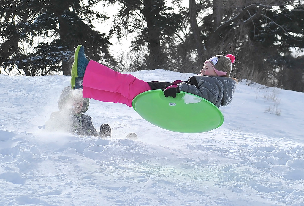 Justin Sheely | The Sheridan Press<br /> Eight-year-old Kortney Fackrell hits a jump at Linden Hill Saturday, Feb. 24, 2018.
