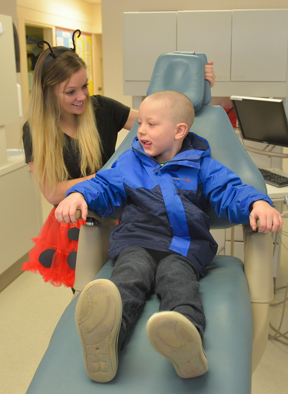 "Justin Sheely | The Sheridan Press<br /> Dental student Katlyn Tippetts, left, gives Sagebrush kindergarteners Xander LaMeres a ride in the chair during Kindergarten Day at the dental hygiene school at Sheridan College Thursday, March 1, 2018. College students in the dental hygiene program invited kindergarten students from Sheridan County schools to visit their ""enchanted forest"" for a positive introduction to the dental world."