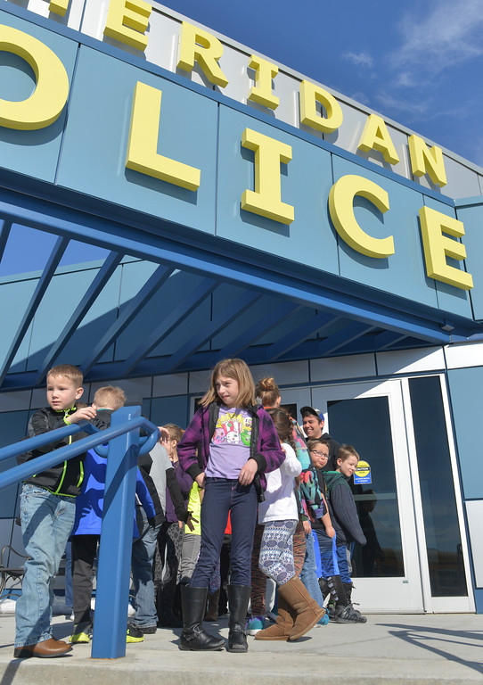Justin Sheely | The Sheridan Press<br /> Big Horn Elementary students gather outside Sheridan Police Department building during a tour for the YMCA's Funday Friday, March 2, 2018.