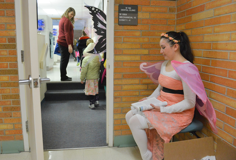 "Justin Sheely | The Sheridan Press<br /> Dental program student Erica Hansen waits to send off the visitors with gift bags during Kindergarten Day at the dental hygiene school at Sheridan College Thursday, March 1, 2018. College students in the dental hygiene program invited kindergarten students from Sheridan County schools to visit their ""enchanted forest"" for a positive introduction to the dental world."