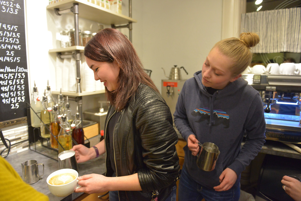 Justin Sheely | The Sheridan Press<br /> Dariene Raymond, left, practices her latte art as Jillian Destefano looks on during the inaugural Barista Jam at Andi's Coffee House Saturday, March 3, 2018. Andi's invited baristas from other businesses to learn techniques for latte art and held a friendly competition at the end of the night. Organizers said they want to help area baristas reach their potential and create a community in specialty coffee.