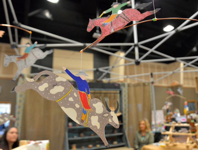 Justin Sheely | The Sheridan Press<br /> Western-themed mobiles hang at a vendor's booth during the Get out and Shop event at Sheridan Wesleyan Church Saturday, March 3, 2018.