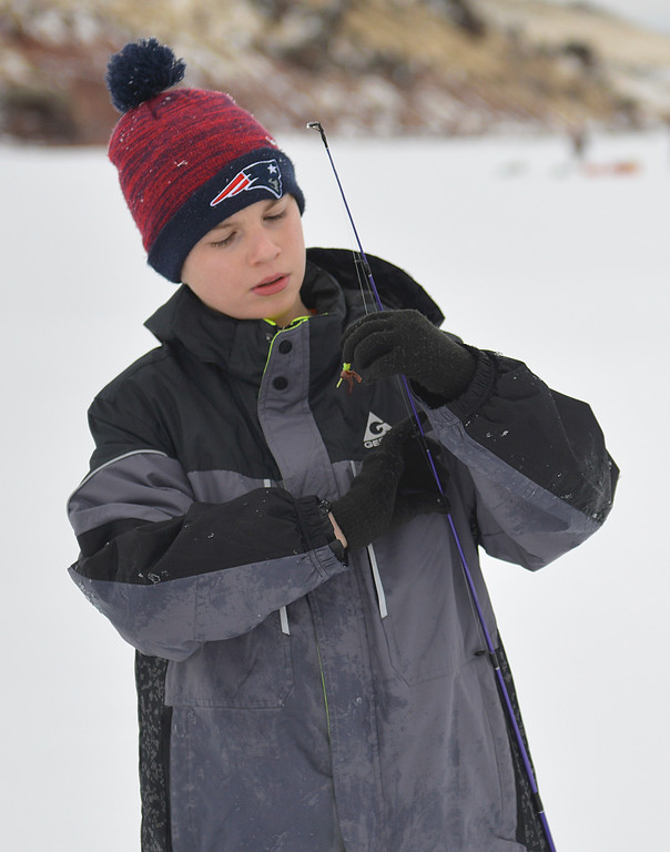 Justin Sheely   The Sheridan Press<br /> <br /> Twelve-year-old David Betts checks on his lure during ice fishing at Lake De Smet Friday, Feb. 2, 2018.