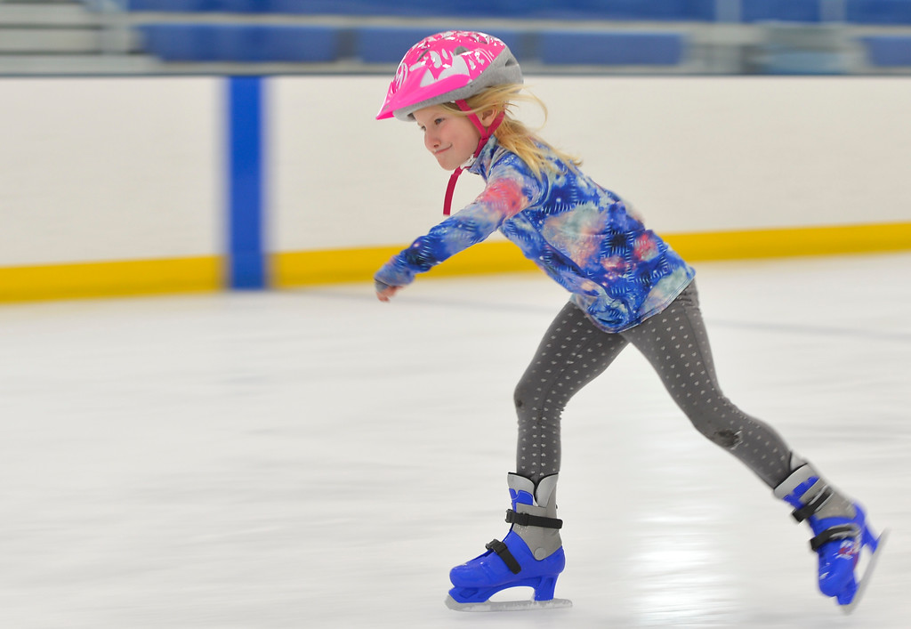 Justin Sheely   The Sheridan Press<br /> <br /> Second-grader Camryn Cooper glides over the ice during open skate at Whitney Rink at the M&M's Center Wednesday, Jan. 31, 2018.