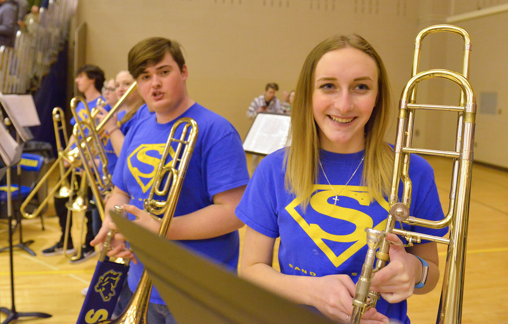 Justin Sheely   The Sheridan Press<br /> <br /> Sheridan seniors Taylor Bowie, right, and Vincent Cossel stand with their trombones ready during the Broncs' game against Campbell County at Sheridan High School Thursday, Feb. 1, 2018.